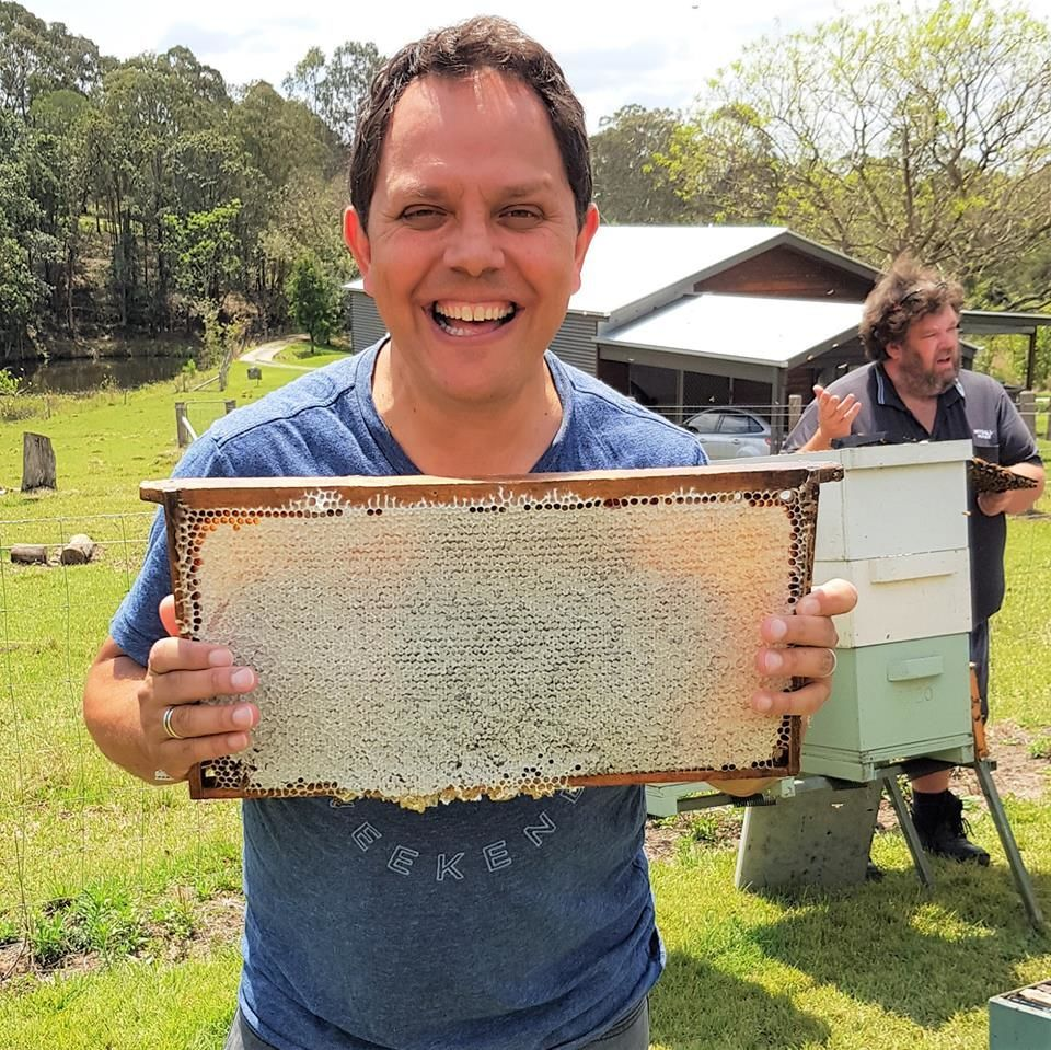 Alastair McLeod holding the first Frame of Samford Sensation Honey, now available for purchase from our online shop